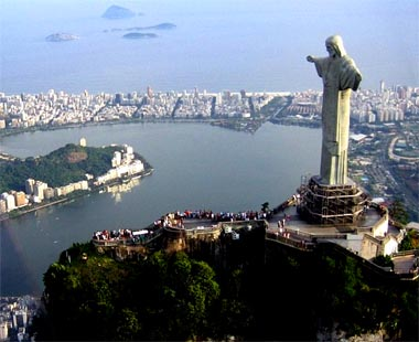 The statue of Christ the Redeemer stands on top of the peak of ...
