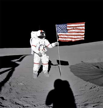 Astronaut Alan Shepard Plants An American Flag On The Moon Notice Wrinkles In And Direction Of Shadows Ground NASA